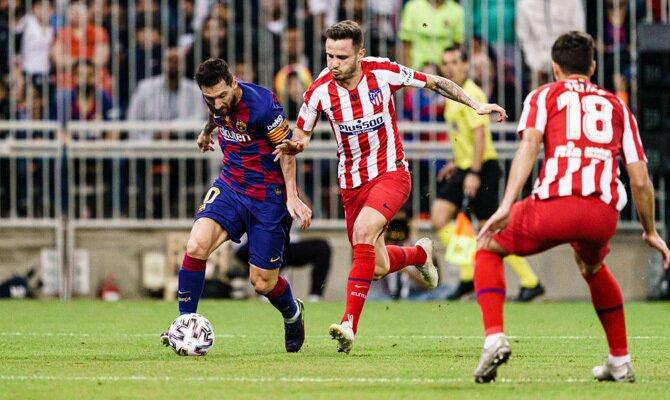Messi y Saúl en un Barcelona vs Atlético de Madrid